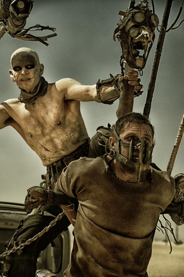 Directors love putting Tom Hardy in a mask... | Photo @MadMaxMovieUK/Twitter